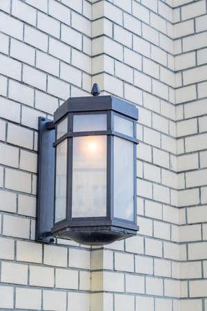close up of street lantern on white brick wall, Street lightning decoration Banco de Imagens