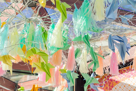 Street decorations made of paper- birds na panicles 스톡 콘텐츠