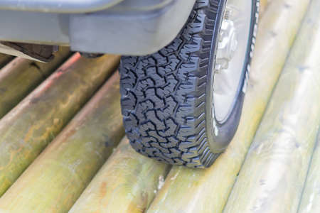 close up of off road tyre on wooden brige