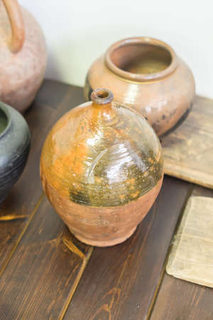 variety of clay pottery standing on wooden table 写真素材