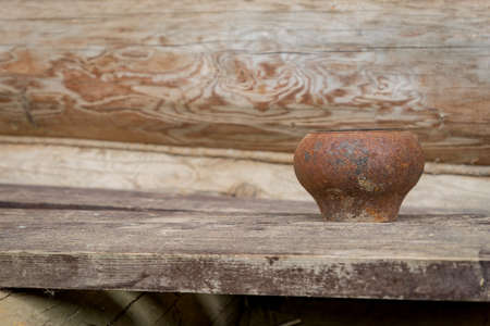 old rusty metal cast-iron on wooden desk outdoors