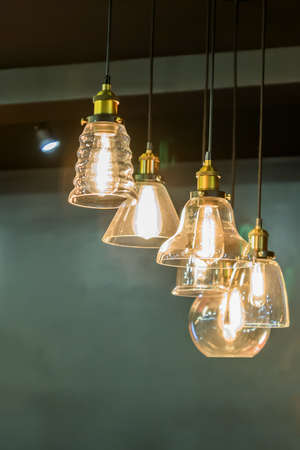 loft interior details. hanging lamps with lights on