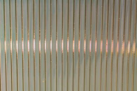 Defocused Polycarbonate plastic sheet, background texture