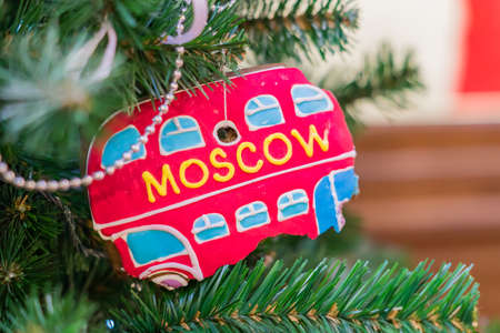 Christmas and New Year holidays background. Christmas tree decorated ginger bread in shape of bus with