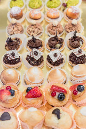 Pastry shop display window with variety of desserts and cakes, selective focus