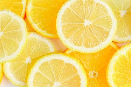 citrus slice, oranges and lemons on white background, Stock fotó