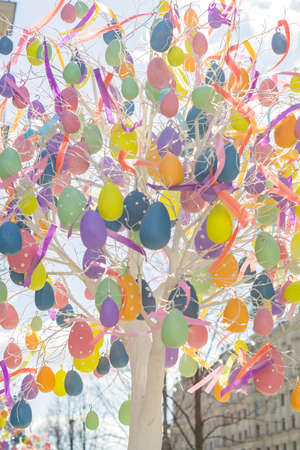 colorfull easter egg tree. brights eggs hanging from branches.