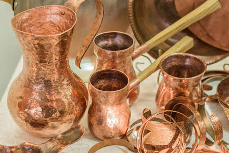 Vintage copper kitchenware - turkish coffee pots and jars displayed in flea market