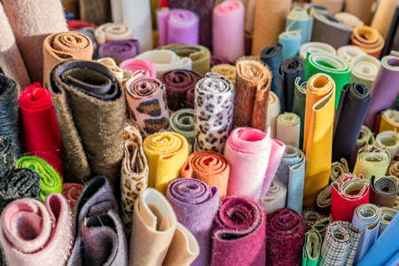 Assortment of natural fabrics and textiles. DIY materiials for craft and scrapbooking. Sewing industry concept
