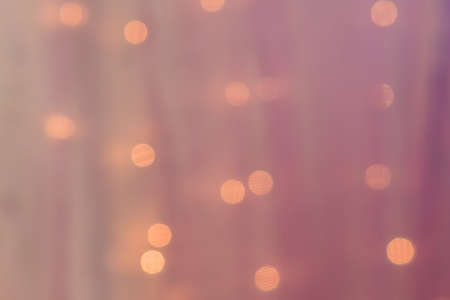 abstract blurred lights on background in pink colors- christmas celebration concept