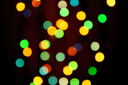 abstract blurred lights on background in blue, green, orange colors. - christmas celebration concept