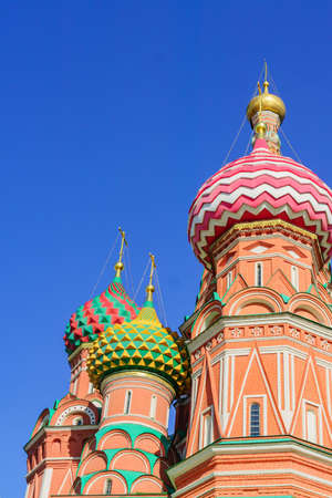 St Basil's cathedral on Red Square in Moscow. Domes the cathedral lit by the sun 免版税图像