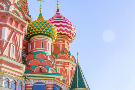 St Basil's cathedral on Red Square in Moscow. Domes the cathedral against blue sky. Copy space