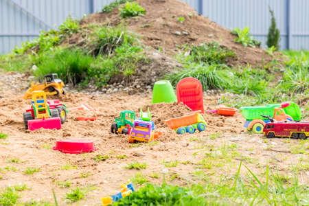 Playground with different toy transportation. Trucks and excavators for playing in the sand Stock fotó