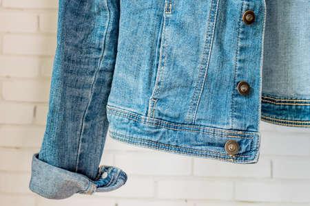 bottom of Blue denim woman jacket. Clothes fragment 版權商用圖片