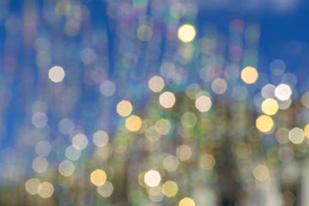 Bokeh abstract texture. Beautiful christmas background in golden and blue colors. Defocused image Banque d'images