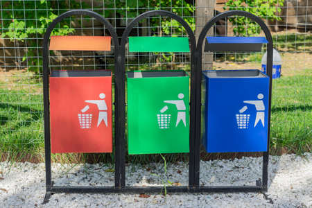 Colorful trash bins for sorting garbage in the park. Waste separate collection and recycling concept