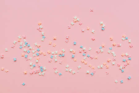 sprinkles background, sugar sprinkle butterflies, decoration for cake and bakery. Top view, flat lay. pastel colors