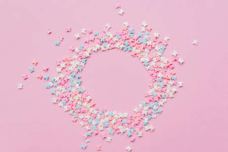 Sprinkles grainy. Sweet confetti. Pink background for holiday designs, party, birthday with copy space Archivio Fotografico