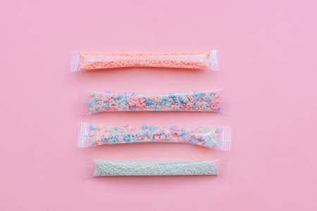 Set of sugar sprinkles of white, pink and blue colors in shape of stars, balls and butterflies. Decoration for cakes and bakery.