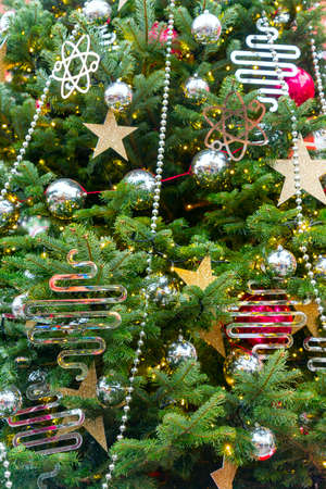 close up of christmas trees decoration with toys and garlands. Festive greeting card for winter holidays.