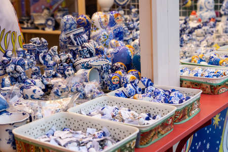 MOSCOW,RUSSIA - December 18, 2019: Colorful porcelain utensils and souvenirs in gzhel style at christmas fair. Traditional russian souvenir. Éditoriale
