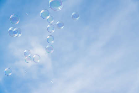 Abstract background, soap bubbles on blue sky background. Copy space for text