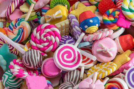 Toys. Colorful lollipops, round candy, cake and different colored sweets. Top view. Candy background.