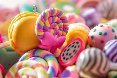 Toys. Spiral lollipop and different colored round candy. Candy background