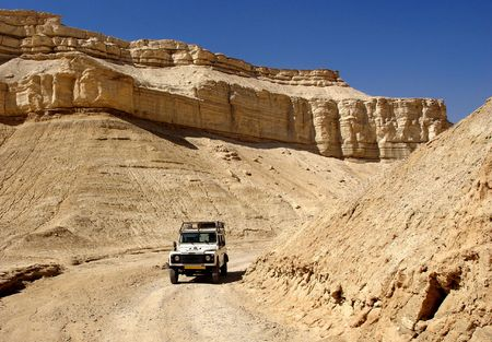 Travel on a jeep in mountains of Judain desert                              Stock Photo