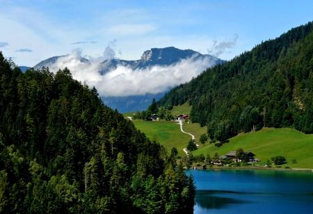 Majestic landscape in mountains of Austria. Small village on lake coast                                Stock Photo
