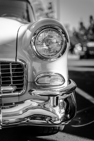 A shiny headlight of a restored classic car photo