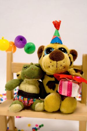 Two little toy friends happy at a birthday party. photo