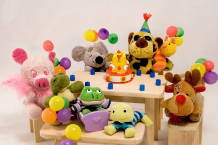 Small animal toys enjoying a birthday party. photo