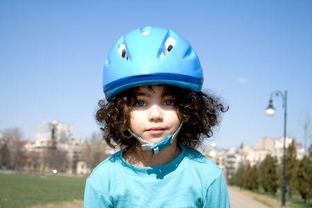 blading: Little girl with blue helmet. Stock Photo