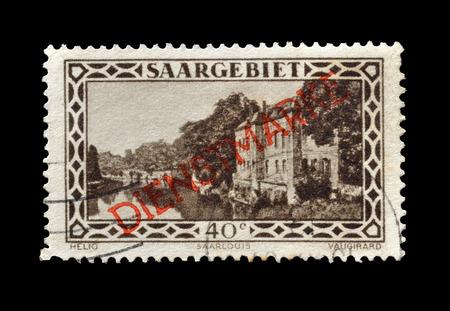 saarlouis: GERMANY - CIRCA 1927 : Postage stamp printed by Germany, that shows Barracks in Saarlouis, overprinted with red letters DIENSTMARKE.