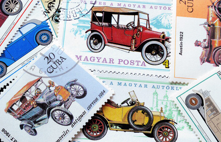 postage stamps: Old cars on postage stamps Editorial