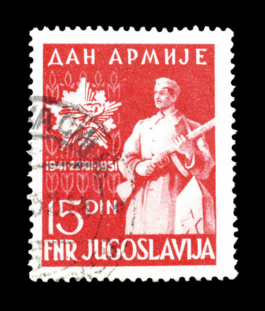 YUGOSLAVIA - CIRCA 1951 : Postage stamp printed by Yugoslavia, that shows soldier and emblem. Editorial