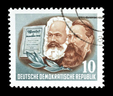 marx: Cancelled postage stamp printed by Germany in 1953, that shows portrait of Marx and Engels.