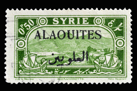 overprint: Cancelled postage stamp printed by Syria, that shows View of Alexandretta, with black overprint Alaouites, circa 1925. Editorial