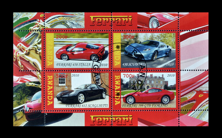 philately: Cancelled set of stamps printed by Rwanda, that show different models of luxurious cars, circa 2010.