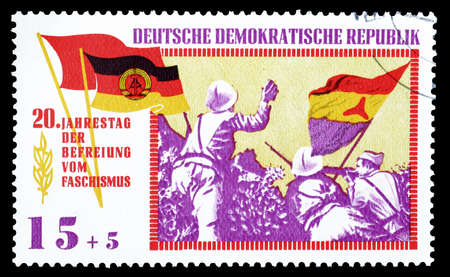 german fascist: Cancelled postage stamp printed by German Democratic Republic, on 20th anniversary of liberation, that shows anti fascist brigade in Spain, circa 1965.