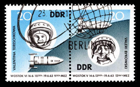 valentina: Cancelled postage stamps printed by German Democratic Republic, that shows Vostok 5 and 6 cosmonauts Valery Bykowsky and Valentina Tereshkowa, circa 1963.