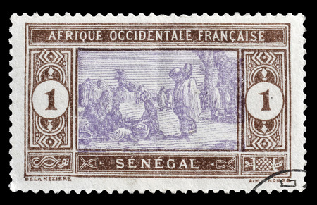 philately: Cancelled postage stamp printed by Senegal, that shows Senegalese preparing food, circa 1914. Editorial