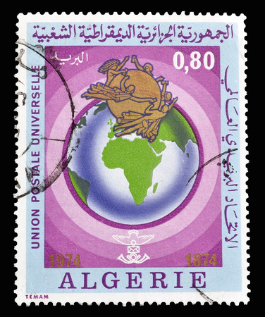 centenary: Cancelled postage stamp printed by Algeria, on UPU Centenary, that shows earth, circa 1974.
