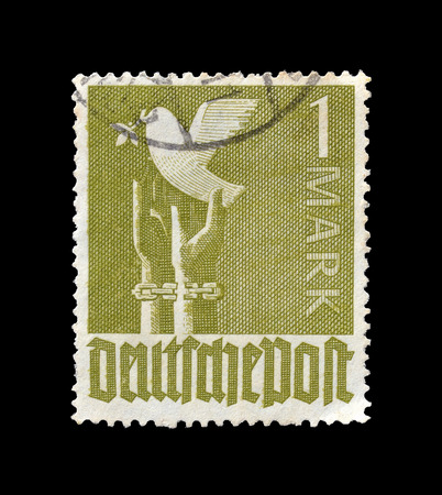 unleashed: Cancelled postage stamp printed by Germany, that shows peace dove unleashed from hands, circa 1947.