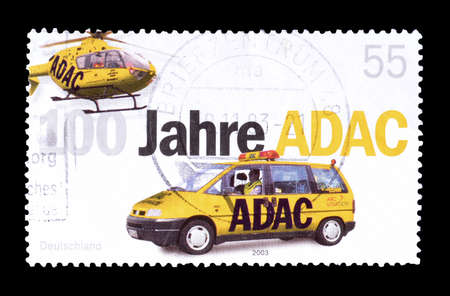philately: Cancelled postage stamp printed by Germany, that shows car and helicopter, circa 2003.