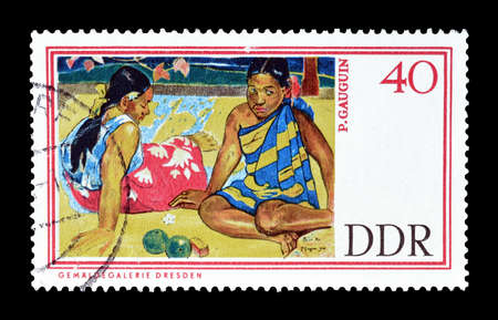 tahitian: Cancelled postage stamp printed by German Democratic Republic, that shows painting of Tahitian Women by Paul Gauguin, circa 1967.