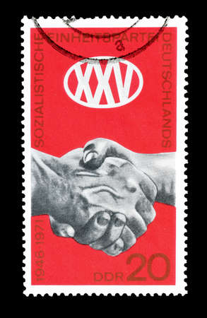 clasped hands: Cancelled postage stamp printed by German Democratic Republic, that shows Clasped hands, circa 1971.