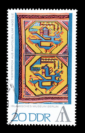 democratic: Cancelled postage stamp printed by German Democratic Republic, that shows Animal carpet from Anatolia, circa 1972.